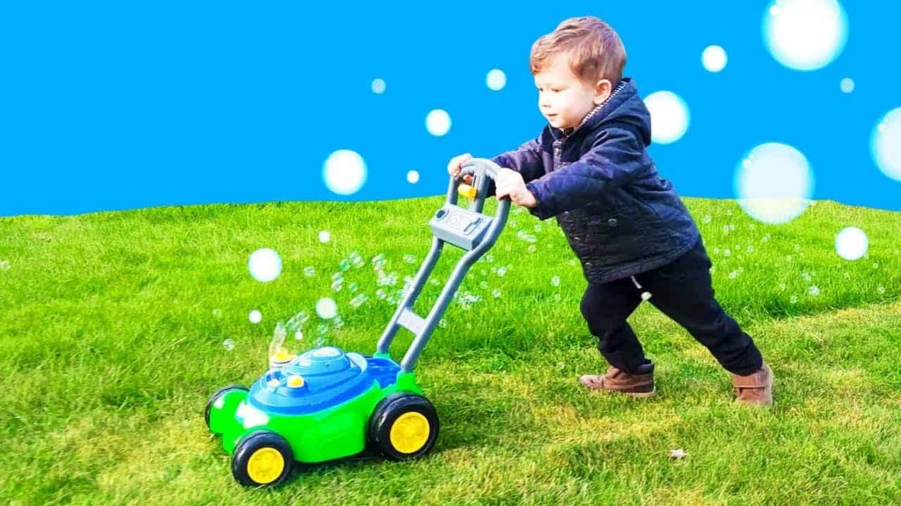 kid playing bubble lawn mower
